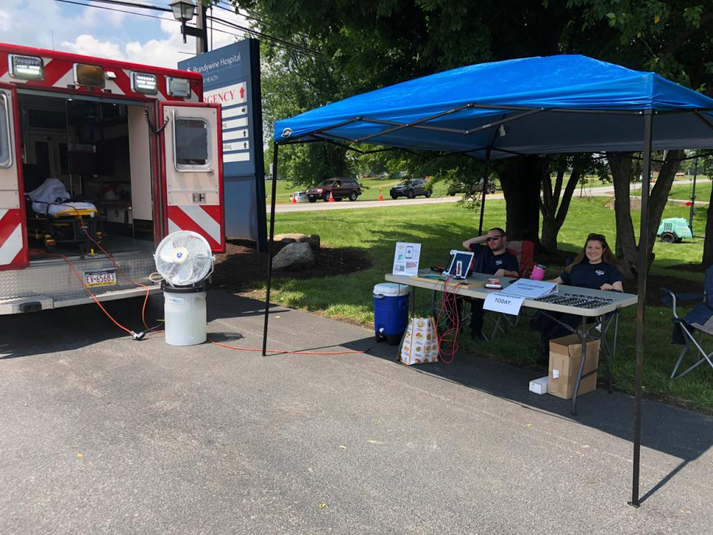 During the 2018 Strawberry Festival WHC EMS Provided a Free Solar Powered Cell Phone Charging Station and Mister Fan to Beat the Heat